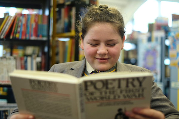 Girl reading poetry book